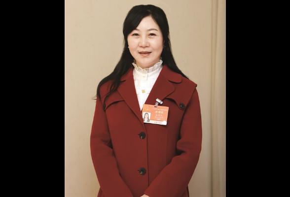 全国人大代表张晓庆:让农民工有尊严地行走在大地上