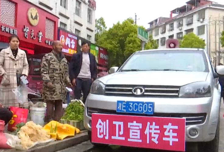 隆回县城管局集中整治洪塘街市容秩序