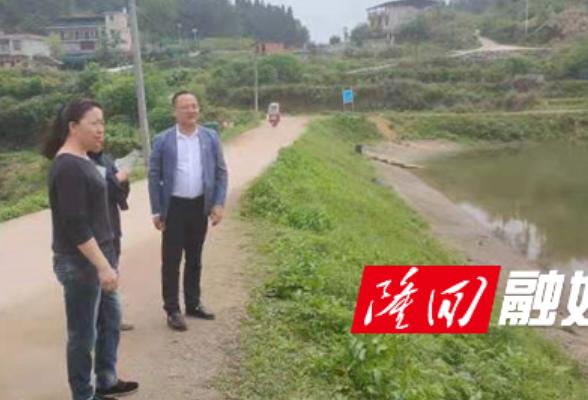 桃花坪街道检查辖区内水库汛期安全