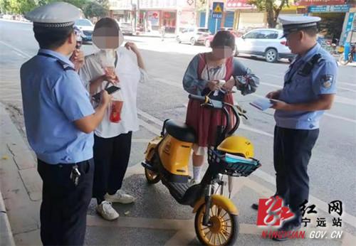 宁远_警企联动 加强共享电单车交通违法整治_副本500.jpg